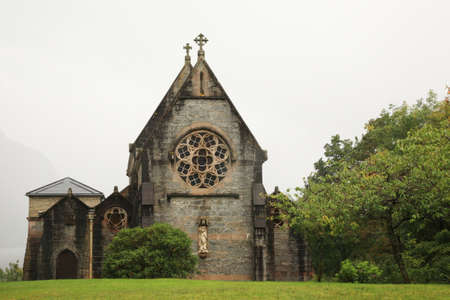 Gothic church Scotland with misty mountains in the background Stock Photo - 8674866