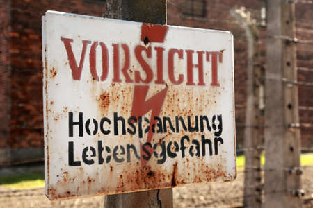 Caution, danger high voltage sign Auschwitz concentration camp, Poland Stock Photo - 17174442