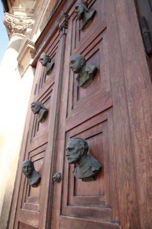 busts: Busts on the door of Mariacki door, Krakow, Poland Stock Photo