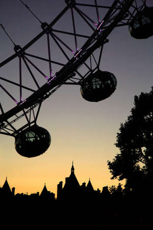 Silhouette of London Eye capsules at dusk photo