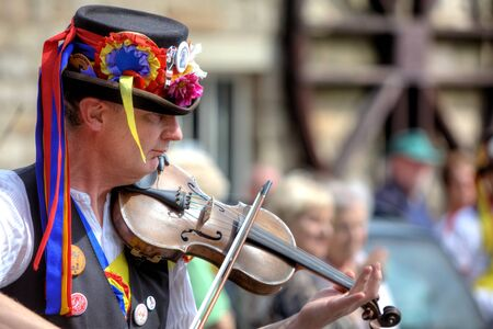 morris: Fiddle player accompanying Morris dancing at the Rushcart Ceremony in Saddleworth, UK on 20th of August, 2011
