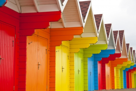 A colourful row of wooden beach huts. Stock Photo