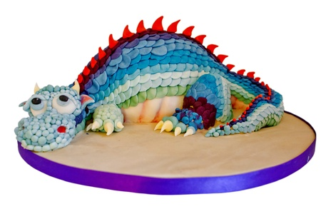 Cake decorated with a colourful merry dragon. photo