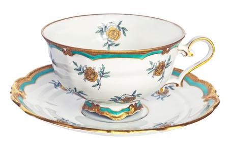 tazza di te: Tazza di tè e piattino antico.