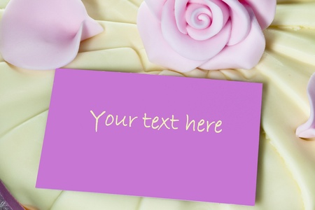notelet: Pink note card on top of an iced cake  Stock Photo
