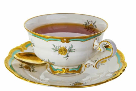 saucers: Antique cup full of tea isolated on white.
