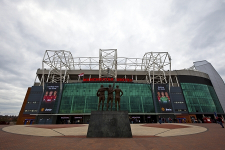 MANCHESTER, UK - April 21: Old Trafford stadium is home to Manchester United one of the wealthiest and most widely supported football teams in the world.  Manchester April 21, 2013.