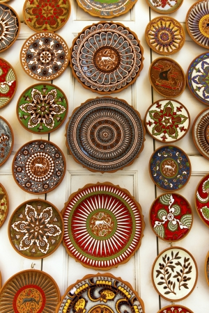 Brightly coloured ceramic plates display in a souvenir shop in Rhodes, Greece.