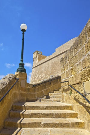 Old narrow steps in Victoria on the island of Gozo, Malta at the Citadel area  photo