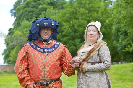 Richly dressed man and woman at Medieval Fayre in Tatton Park, Cheshire, England