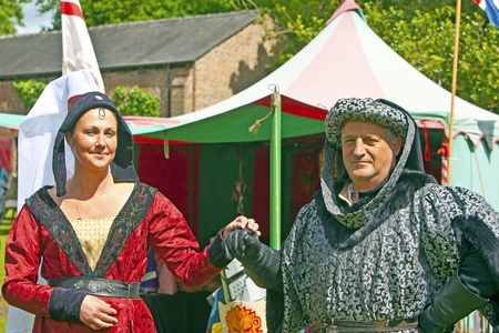 annual events: Senior man and young woman in medieval costume participants at The Medieval Fayre one of the most popular annual events of the Tatton Park in Cheshire, 15, June 2013   Editorial