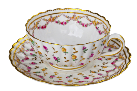 Elegant antique china tea cup and saucer isolated on white  photo