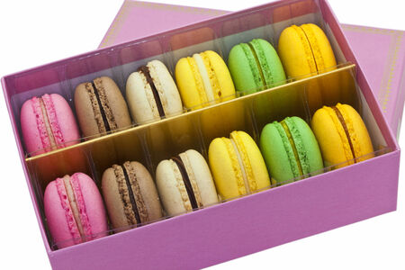 Multicoloured macaroon biscuits in pink box  photo