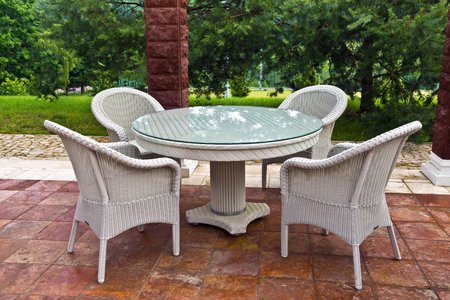 White table and chairs patio furniture in a garden s gazibo