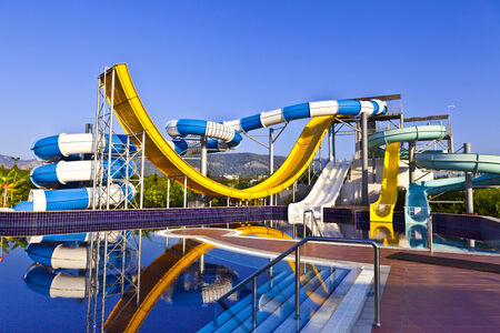 yeloow: Blue, white and yeloow waterslide in a pool.