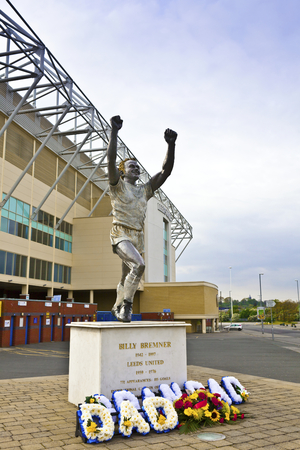memorabilia: LEEDS, UK - MAY 4, 2014: A statue of former Leeds captain Billy Bremner at Elland Road stadium, home of Leeds United Football Club since 1919 following the disbanding of Leeds City F.C.