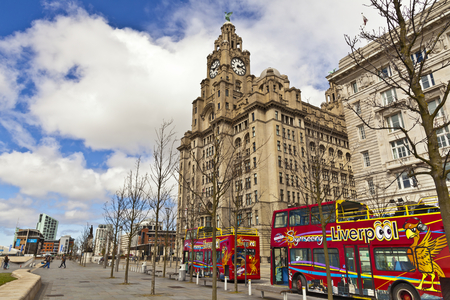 LIVERPOOL UK  MAY 3 2015: Cityscape at the Pier Head the city centre of Liverpool England part of the Liverpool Maritime Mercantile City UNESCO World Heritage Site.