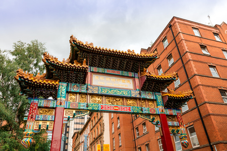 enclave: MANCHESTER, UK - AUGUST 9, 2015: Great imperial archway, an official gift from Beijing, is the imposing gateway to Manchester Chinatown and is the only one of its kind in Europe.