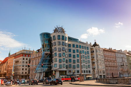 nicknamed: PRAGUE, CZECH REPUBLIC - NOVEMBER 14, 2015: Street view with very non traditional designed Dancing House on the Rasin Embankment nicknamed as Fred and Ginger House after the famous dancers.