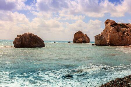 tou: Seascape with Petra tou Romiou, also known as Aphrodites Rock, is a sea stack in Paphos, Cyprus. Stock Photo