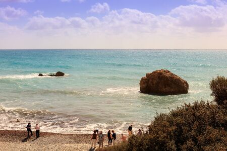 tou: Tourists at the seaside by the Petra tou Romiou (Rock of the Greek), also known as Aphrodites Rock. Editorial