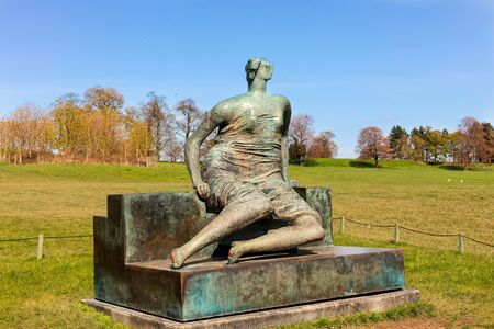 henry: WAKEFIELD, YORKSHIRE, UK APRIL  19TH 2016:  Draped Seated Woman, c1957-58 bronze sculpture by Henry Moore in Yorkshire Sculpture Park.