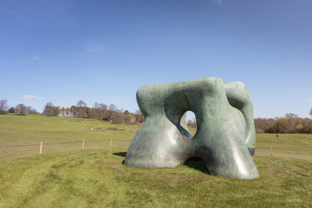 WAKEFIELD, YORKSHIRE, UK - APRIL 19, 2016:  Large two forms bronze sculpture by Henry Moore in Yorkshire Sculpture Park.