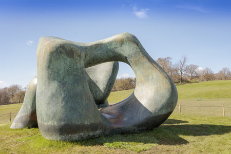 henry: WAKEFIELD, YORKSHIRE, UK - APRIL 19, 2016:  Large two forms bronze sculpture by Henry Moore in Yorkshire Sculpture Park.