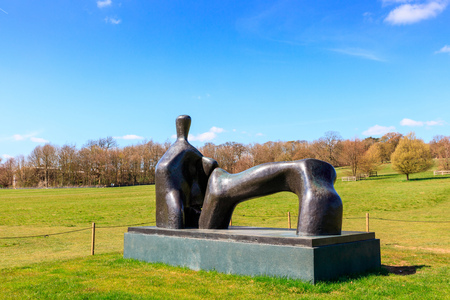 WAKEFIELD, YORKSHIRE, UK - APRIL 19, 2016: Reclining Figure bronze sculpture by Henry Moore in Yorkshire Sculpture Park.
