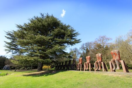 The great Polish artist Magdalena Abakanowicz returns to YSP with the UK premiere of her monumental sculpture, Ten Seated Figures. Stock Photo