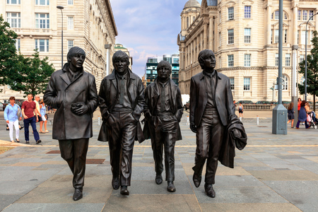 LIVERPOOL, UK - AUGUST 18, 2016:  Bronze statue of the four Liverpool Beatles stands on Liverpool Waterfront by sculptor Andrew Edwards. Editorial
