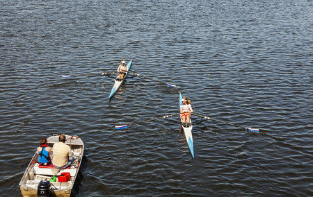 sculling: MANCHESTER, ENGLAND - MAY 29, 2016: Single scull rowing competitors in training. Editorial