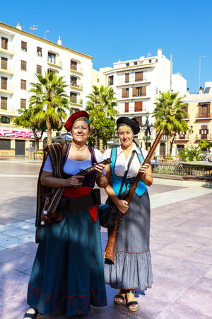 corsair: ALGECIRAS, SPAIN - SEPTEMBER 24, 2016: Two ladies in corsair costume with guns at the Plaza Alta in Algeciras, Spain. Editorial