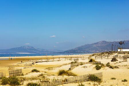White sandy beaches of the Atlantic shore at Spanish coast of Playa De Los Lances in Tarifa, Spain. Stock Photo