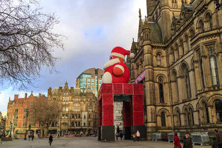 MANCHESTER, UK - DECEMBER 26, 20016: Historic Manchester Town Hall Designed by architect Alfred Waterhouse decorated for festive season with a figure of Father Christmas.