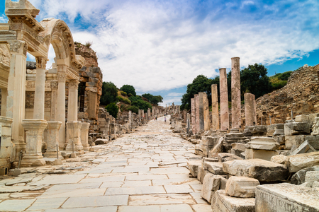 Ancient Roman Archaeological site with facade of the Library of Celsus in Ephesus, Anatolia is a popular tourist attraction.