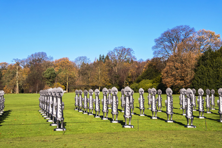 WAKEFIELD, YORKSHIRE, UK - NOVEMBER 24, 2017: Black and Blue: The Invisible Men and the Masque of Blackness, a mass of identical two-metre-tall figures by Zac Ove.