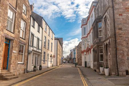 CAERNARFON, UK - September 9, 2018: Narrow old street in Caernarfon, Wales with elegant Georgian houses. Editorial