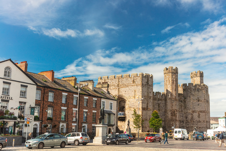CAERNARFON, UK - September 9, 2018: Caernarfons Castle Square with elegant Georgian and Victorian buildings foreground to the Medieval Castle. Editorial