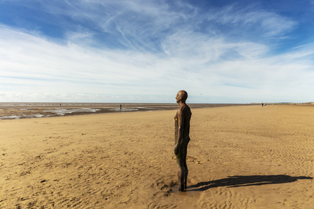 Deserted beach at Crosby near Liverpool with cast iron sculptures Another Place by Antony Gormley.