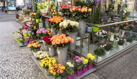 Small florist shop display with roses and chrysanthemums for sale. Stock Photo