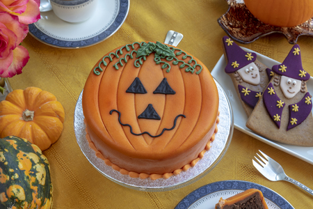 Novelty cake decorated with marzipan and icing in Halloween pumpkin theme. 写真素材