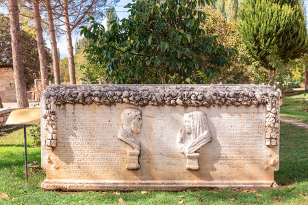 Ancient Greek family tomb decorated with stone relief carvings in ancient city of Aphrodisias in Aydin province of  Turkey.