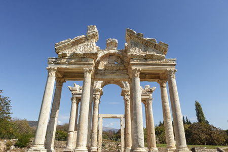 The Tetrapylon (monumental gate) at an archaeological site of Helenistic city of Aphrodisias in  western Anatolia, Turkey. Stock Photo