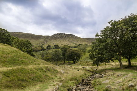 Rural landscape with steep limestone valleys at the Peak District National Park is in central England.