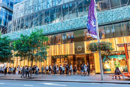 SYDNEY, AUSTRALIA - March 31, 2019: Long queue outside large luxury designer store Gucci in central Sydney, Australia.