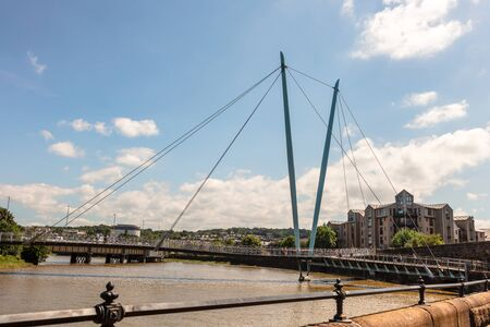 Landscape with River Lune Millennium Bridge in the city of Lancaster, England.
