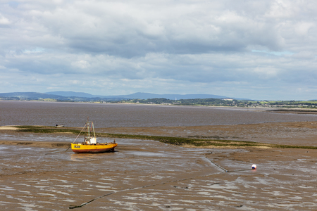 MORECAMBE, UK - July 2, 2019: Tide is out in Morecambe Bay in Lancashire exposing sandy seabed. Editorial