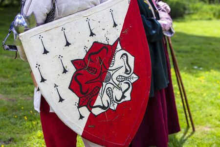 Red and white roses shield at a medieval festival.