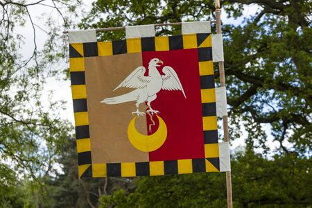 Eagle and crescent flag at medieval fayre.